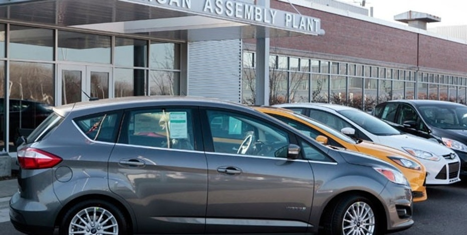A Ford 2013 Ford C-MAX Hybrid vehicle is seen on display outside the Michigan Assembly Plant in Wayne, Michigan.