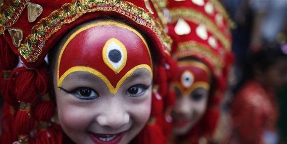 A young Nepalese girl dressed as a Kumari smiles in this 2013 file photo.