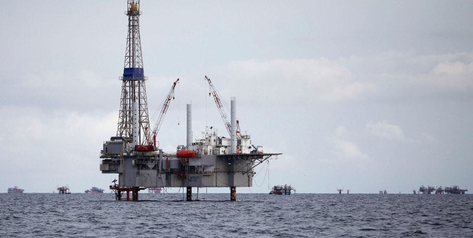 A view of a drilling rig and distant production platform in the Soldado Field off Trinidad's southwest coast, September 10, 2011. REUTERS/Andrea De Silva (TRINIDAD AND TOBAGO - Tags: ENERGY)