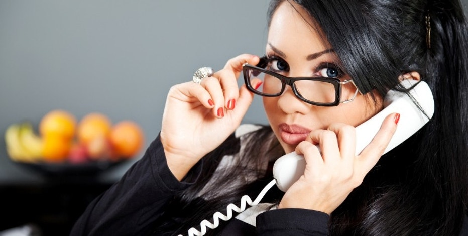 young hispanic business person with eyeglasses on the phone