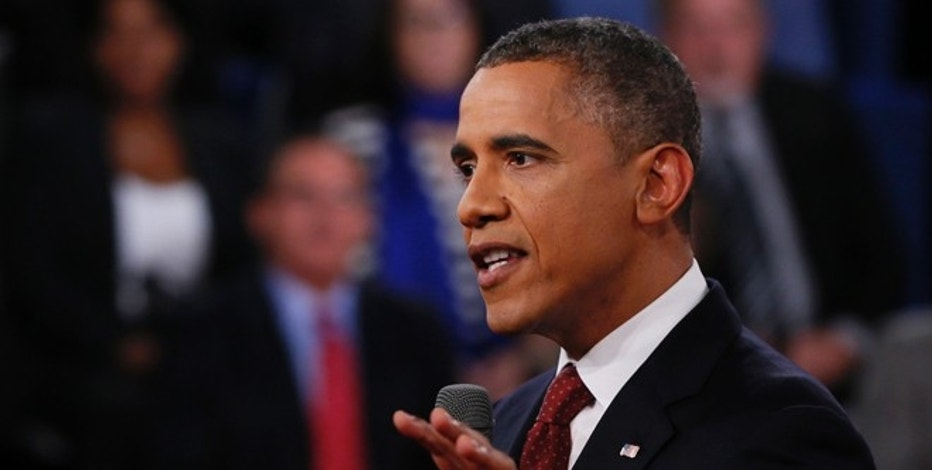 President Barack Obama addresses members of the audience during the second presidential debate with Republican presidential nominee Mitt Romney at Hofstra University, Tuesday, Oct. 16, 2012, in Hempstead, N.Y. (AP Photo/Pool-Shannon Stapleton)