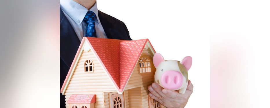 Businessman with house model and bank, Concept for retirement