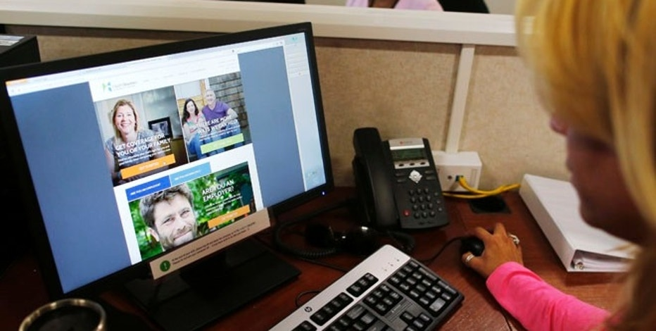 A man looks over Obamacare signup page in New York on October 2, 2013.