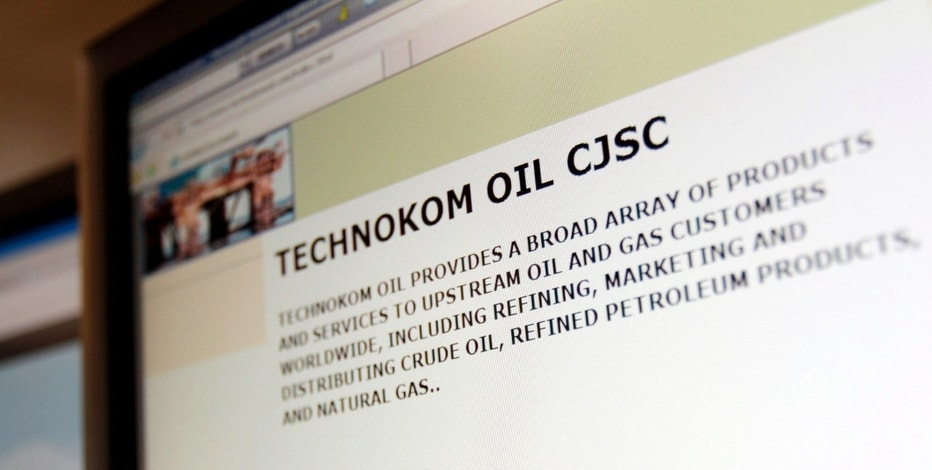 A photo illustration shows the Technokom Oil website on a computer screen in London, August 9, 2011. When hedge fund manager Alberto Micalizz bought bonds backed by oil from an obscure Russian republic he trapped his investors in a secret - and very global - web which included the company Technokom Oil. Picture taken August 9, 2011. To match Special Report PHANTOM-BOND/    REUTERS/Simon Newman (BRITAIN - Tags: BUSINESS SCI TECH)