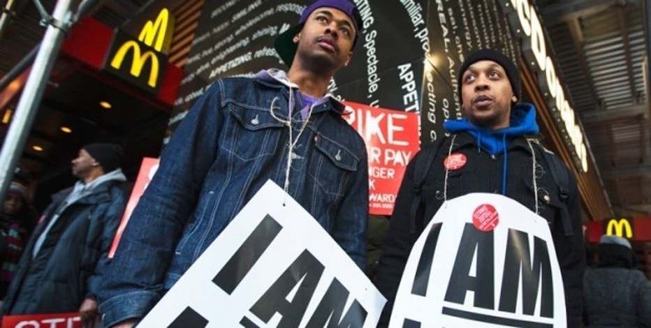 Demonstrators protesting low wages and the lack of union representation in the fast food industry stand outside of a McDonald's restaurant near Times Square in New York, April 4, 2013