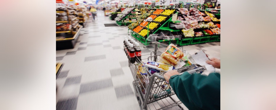 Michael Lipsitz does his grocery shopping at the WalMart in Crossville, Tennessee March 21, 2008.   Food prices are soaring, a wealthier Asia  is demanding better food and farmers can?t keep up. In short, the world is in a food crisis that is in danger of boiling over.            
