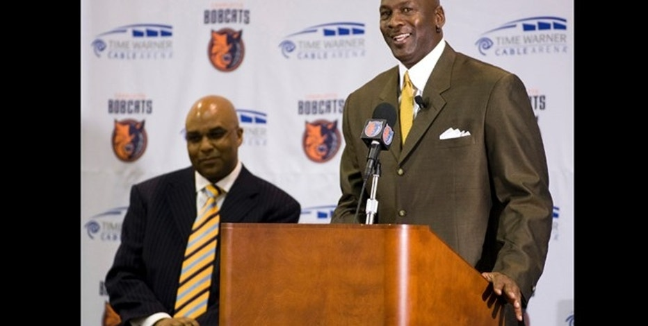 New Charlotte Bobcats majority owner Michael Jordan speaks next to Bobcats President Fred Whitfield (L) during a news conference in Charlotte, North Carolina March 18, 2010. Jordan became the first former NBA player to be the majority owner of a team when he was unanimously approved to take over the Charlotte Bobcats by the league on Wednesday. REUTERS/Chris Keane (UNITED STATES - Tags: SPORT BASKETBALL IMAGES OF THE DAY) - RTR2BSV1