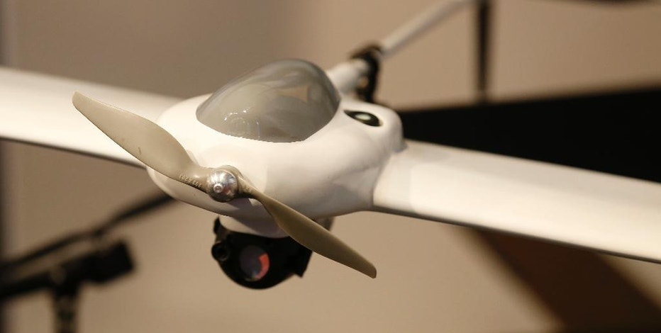 An AeroVironment Wasp AE small unmanned aircraft system is displayed at the AeroVironment stand during Farnborough International Air Show, Farnborough, England, Tuesday, July 15, 2014. (AP Photo/Sang Tan)