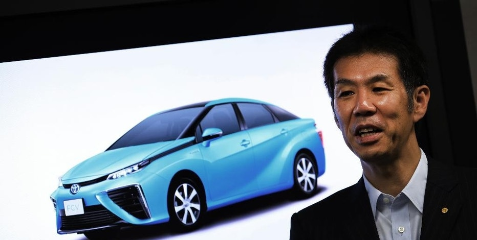 In this July 10, 2014 photo, Toyota Motor Corporation Managing Officer Satoshi Ogiso talks about Toyota FCV fuel cell vehicle during an interview with The Associated Press in Tokyo. Toyota's still-to-be-officially-named vehicle goes on sale in Japan sometime before April 2015, and within a half year after that in the U.S. and Europe.  Ogiso, the engineer leading the Toyota project, is confident there's a market that will grow in significance over time.  Ogiso, like many other experts, believes that reliance on gasoline is not sustainable in the long-run particularly with rapid growth in ownership in developing nations, which could translate into hundreds of millions of additional cars on the roads globally.  (AP Photo/Eugene Hoshiko)
