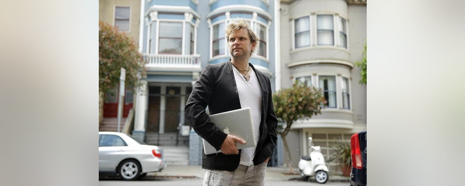 In this photo taken Wednesday, July 16, 2014, Gerry Kelly, founder of clothing brand Sonas Denim and a Bubblews user, poses near his home in San Francisco. Kelly has already earned nearly $100 from Bubblews since he began using a test version in January. His Bubblews feed serves as a journal about the lessons he has learned in life, as well as a forum for his clothing brand. (AP Photo/Eric Risberg)