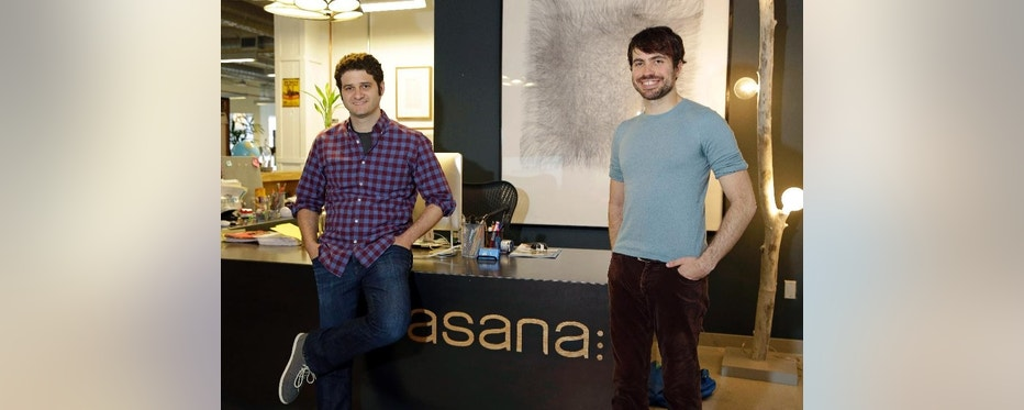 In this photo taken Thursday, April 3, 2014, Asana co-founders Dustin Moskovitz, left, and Justin Rosenstein, pose at the company's headquarters in San Francisco. Asana peddles software that combines the elements of a communal notebook, social network, instant messaging application and online calendar to enable teams of employees to share information and do most of their jobs without relying on email. (AP Photo/Eric Risberg)
