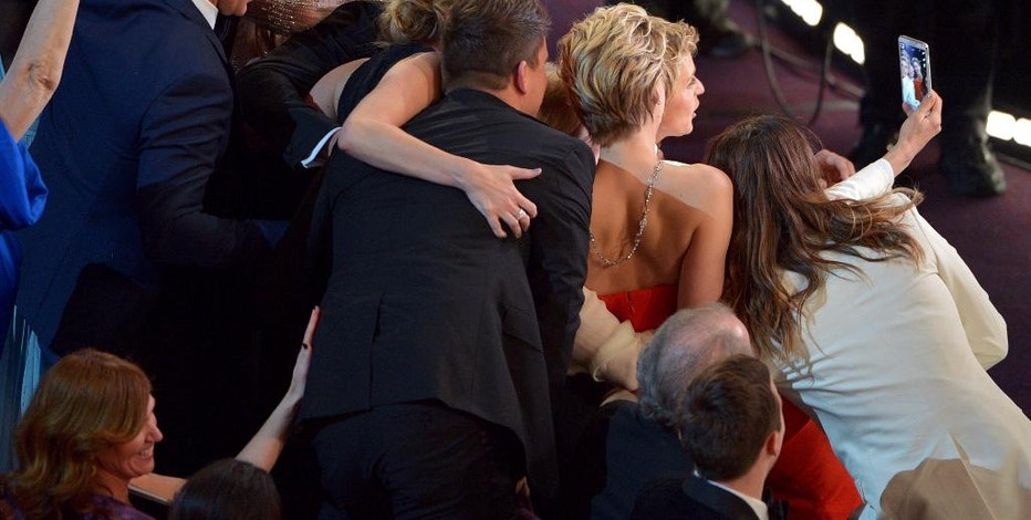 FILE - This March 2, 2014 file photo shows Kevin Spacey, from left, Angelina Jolie, Julia Roberts, Brad Pitt, Jennifer Lawrence, Ellen Degeneres and Jared Leto join other celebrities for a group selfie during the Oscars at the Dolby Theatre  in Los Angeles.  (Photo by John Shearer/Invision/AP, File)