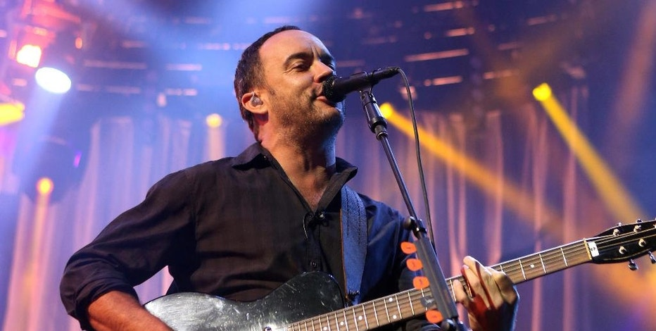 FILE - In this June 28, 2013 file photo, Dave Matthews of The Dave Matthews Band performs on stage at the Susquehanna Bank Center in Camden, N.J. Live Nation's partnership with Yahoo to stream one concert live every day _ which began with the Dave Matthews Band on July 15, 2014 _ is a rare win for music fans because it gives them high-quality concert footage for free in a way that also helps the companies providing it.  (Photo by Owen Sweeney/Invision/AP, File)