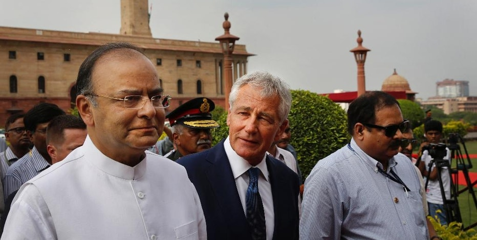 U.S. Defense Secretary Chuck Hagel, center, talks with Indian Defense Minister Arun Jaitley as they walk for a meeting in New Delhi, India, Friday, Aug. 8, 2014. Hagel is on a three day official visit to India. (AP Photo /Manish Swarup)