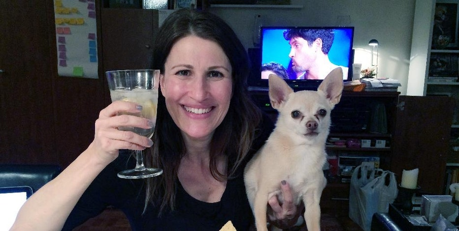 In this May 5, 2014 photo provided by Dana Humphrey, Joanie Pelzer poses with her dog Hubbell, a 9-year-old Chihuahua, in New York. When Pelzer signed up with a dog-friendly online dating service a few years ago, she was honest about her Chihuahua: He likes people more than other dogs, craves attention, steals food and can't stand to ride in the backseat of a car. Even with a man who loved animals as much as she did, he couldn't keep up with her dog's quirks. On their first date, Hubbell stole the man's breakfast as they drove from New York City to Long Island. They only had one more date. (AP Photo/Dana Humphrey)