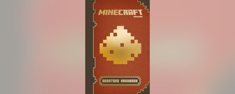"This photo provided by Scholastic shows the cover of the book, ""Minecraft: Essential Handbook."" (AP Photo/Scholastic)"