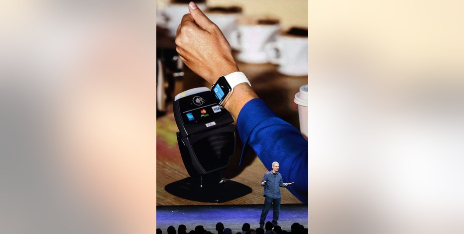Apple CEO Tim Cook explains how the Apple Watch works in conjunction with Apple Pay during an announcements of new products on Tuesday, Sept. 9, 2014, in Cupertino, Calif. (AP Photo/Marcio Jose Sanchez)