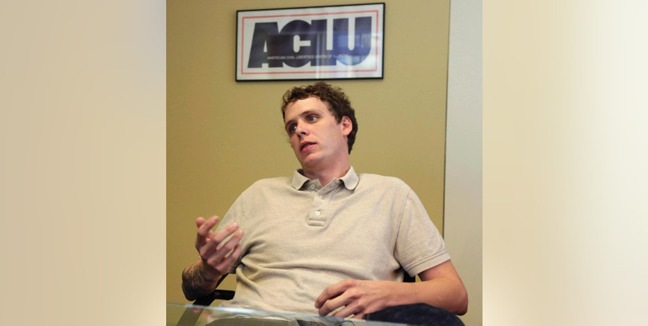 In this Aug. 7, 2014 photo, Jon Daniel speaks during an interview with The Associated Press at the American Civil Liberties Union of Illinois office in Chicago. Daniel, who created a spoof Twitter account in the name of Peoria Mayor Jim Ardis, is taking his case to federal court after police raided his home. Ardis saw the account as an attempt to steal his identity. Daniel says the raid violated his constitutional rights. The police response also ignited a debate about online satire and free speech. (AP Photo/M. Spencer Green)