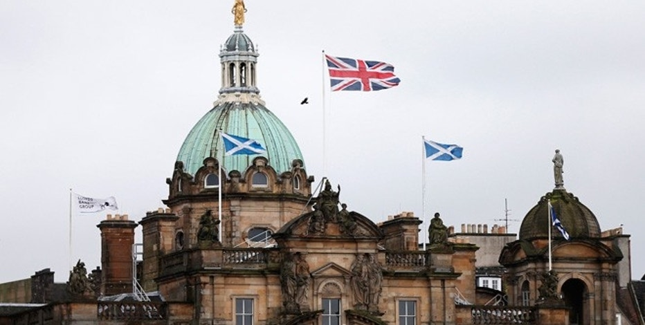British and Scottish flags fly outside the Lloyds Banking Group's Scottish headquarters in Edinburgh, Scotland.