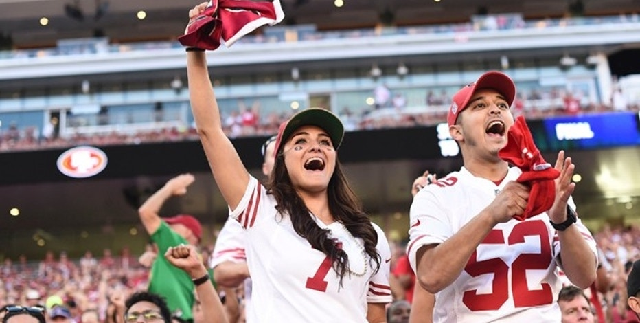 In this Sept. 14, 2014 photo, San Francisco 49ers fans cheer at Levi's Stadium during the first half of an NFL football game against the Chicago Bears in Santa Clara, Calif. If 49ers CEO Jed York realizes his vision, Levi's Stadium will channel Silicon Valley's ingenuity to become known as a technology temple programmed to pamper and connect fans who are more accustomed to being corralled in congested venues with little or no Internet access. (AP Photo/Noah Berger)