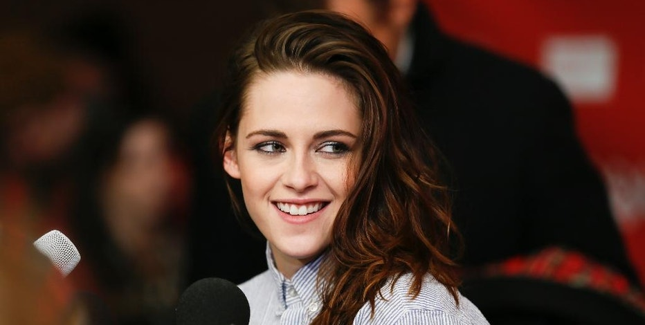 "FILE - In this Jan. 17, 2014 file photo, actress Kristen Stewart smiles at the premiere of the film ""Camp X-Ray"" during the 2014 Sundance Film Festival in Park City, Utah. Stewart will be among the panelists selecting the winners for a short film competition. At least five young female directors will be chosen to direct shorts based on characters from ""Twilight."" The films will debut on Facebook sometime next year. (Photo by Danny Moloshok/Invision/AP, File)"