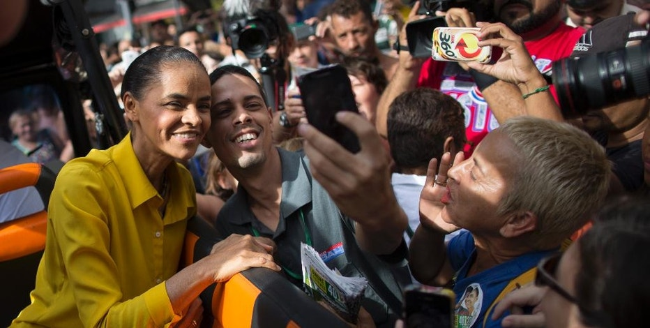 Marina Silva, presidential candidate of the Brazilian Socialist Party, PSB, poses for photos with supporters at a campaign rally in Rio de Janeiro, Brazil, Friday, Oct. 3, 2014. Brazil will hold general elections on Oct. 5. (AP Photo/Felipe Dana)