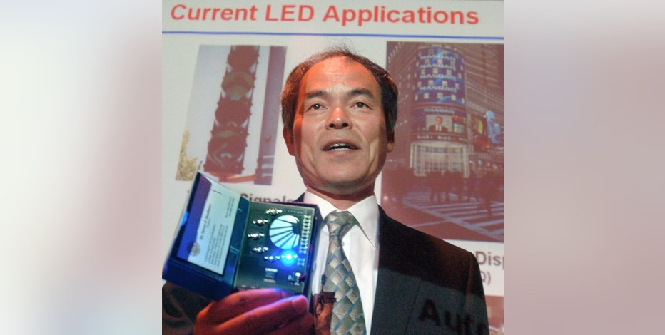 FILE - In this June 15, 2006 file photo, Prof. Shuji Nakamura demonstrates different LED lights during a presentation in Santa Barbara, Calif. when he was awarded the $1.2 million Millennium Technology Prize for revolutionary inventions in light and laser technology. Nakamura along with Isamu Akasaki and Hiroshi Amano of Japan won Tuesday, Oct. 7, 2014 the Nobel Prize in physics for the invention of blue light-emitting diodes — a new energy efficient and environment-friendly light source. (AP Photo/The News Press, Steve Malone, File) NO SALES
