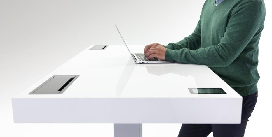 "This undated product image provided by Stir shows the Stir Kinetic desk. The Stir Kinetic is probably the world's first ""smart"" desk. It has a built-in touch screen, so you can see this either as a desk with a smartphone in it or a smartphone with a desk attached. (AP Photo/Stir)"
