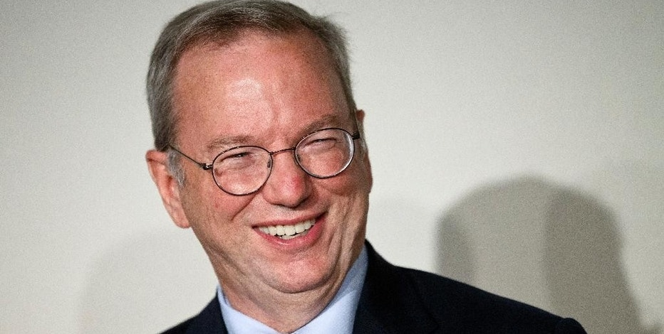 "FILE - In this Sept. 9, 2014 file photo, Google Executive Chairman Eric Schmidt smiles during a meeting about the ""right to be forgotten"" in Madrid. Sen. Ron Wyden, D-Ore., on Wednesday, Oct. 8, 2014  convened a roundtable including Schmidt and top corporate attorneys from Facebook and Microsoft to discuss the economic fallout from the surveillance programs revealed last year by former National Security Agency contractor Edward Snowden. (AP Photo/Daniel Ochoa de Olza, File)"