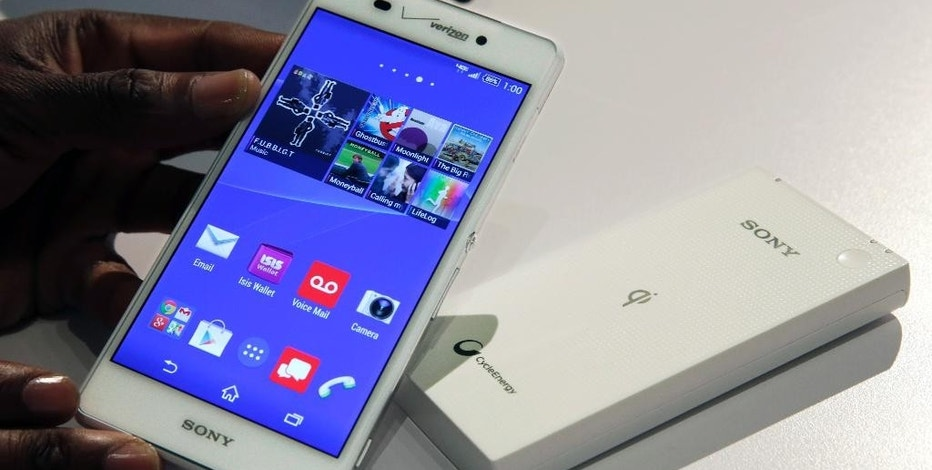 The Sony Xperia Z3v smartphone, available through Verizon, with an optional accessory to charge the phone wirelessly, is presented during a media event in New York on Thursday, Oct. 9, 2014. The Verizon phone comes out Oct. 23, just a month after Apple released larger-screen iPhones and a week after the Oct. 17 release of Samsung's new Galaxy Note 4 phone.  (AP Photo/Richard Drew)