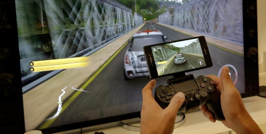 The Sony Xperia Z3v smartphone, available through Verizon, is connected to a Sony PS4 Remote Play during a demonstration at a media event in New York, Thursday Oct. 9, 2014. The Verizon phone comes out Oct. 23, just a month after Apple released larger-screen iPhones and a week after the Oct. 17 release of Samsung's new Galaxy Note 4 phone. (AP Photo/Richard Drew)