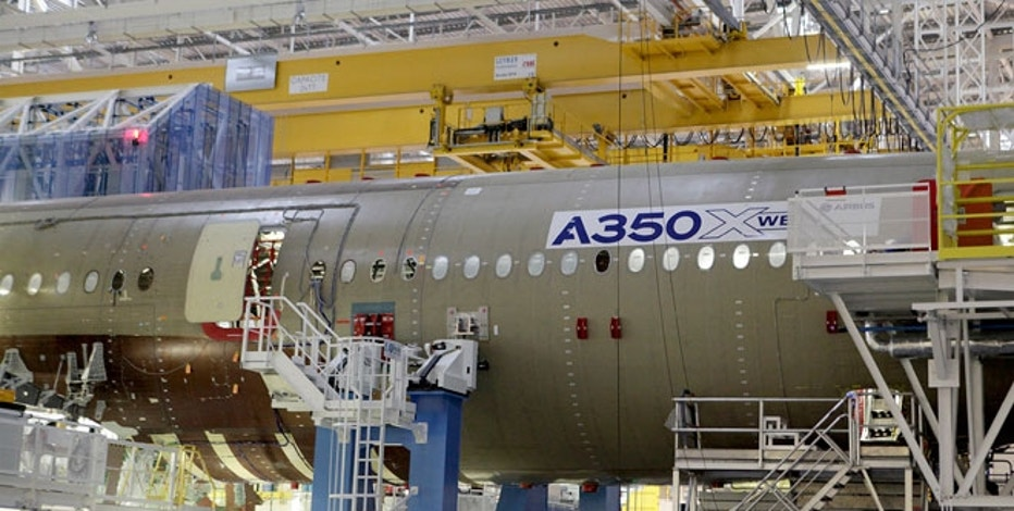 The main body section of the first Airbus A350 is seen on the final assembly line in Toulouse, southwestern France.