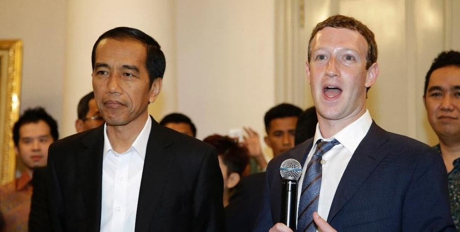 Facebook CEO Mark Zuckerberg, right, speaks during a joint press conference with Indonesian President-elect Joko Widodo, left, after their meeting in Jakarta, Indonesia, Monday, Oct. 13, 2014. Zuckerberg and Widodo discussed ways to take advantage of the online social networking service for beneficial of national development. (AP Photo/Achmad Ibrahim)