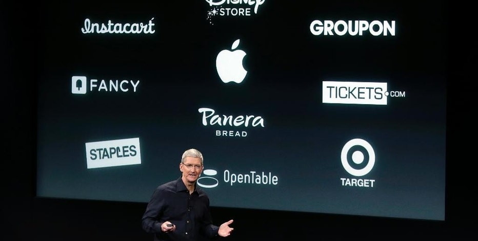 Apple CEO Tim Cook discusses the new Apple Pay product during an event at Apple headquarters on Thursday, Oct. 16, 2014 in Cupertino, Calif. (AP Photo/Marcio Jose Sanchez)