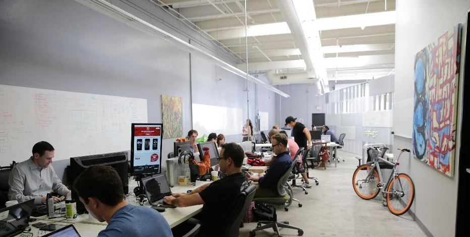 In this Aug. 12, 2014 photo, employees of Rivalry Games work on their computers at technology incubator MuckerLab, in Santa Monica, Calif. The relocation of tech companies to southern California is part of a growing movement of U.S. cities seeking to duplicate the formula that turned northern California's Silicon Valley, slightly south of San Francisco, into a mecca of society-shifting innovation and immense wealth. (AP Photo/Jae C. Hong)