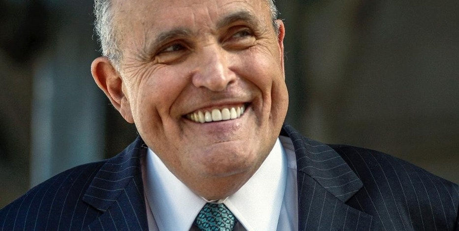 """In this Thursday, Oct. 16, 2014 file photo, lawyer and former New York City Mayor Rudy Giuliani speaks at a press conference after appearing in court to call for the dismissal of a lawsuit filed against video game giant Activision by former Panamanian dictator Manuel Noriega outside Los Angeles Superior Court in Los Angeles. A Los Angeles judge dismissed Noriega's lawsuit against Activision Blizzard, Inc. on Monday Oct. 27, 2014. Noriega had sued over his inclusion in 2012's """"Call of Duty: Black Ops II"""" video game, but Superior Court Judge William Fahey ruled that Activision had created a complex and multi-faceted game that relied very little on Noriega. (AP Photo/Damian Dovarganes, File)"""