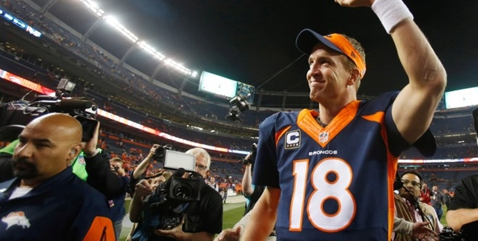 Oct 19, 2014; Denver, CO, USA; Denver Broncos quarterback Peyton Manning (18) waves to the crowd as he runs off the field after the game against the San Francisco 49ers at Sports Authority Field at Mile High. Mandatory Credit: Chris Humphreys-USA TODAY Sports - RTR4ARX9
