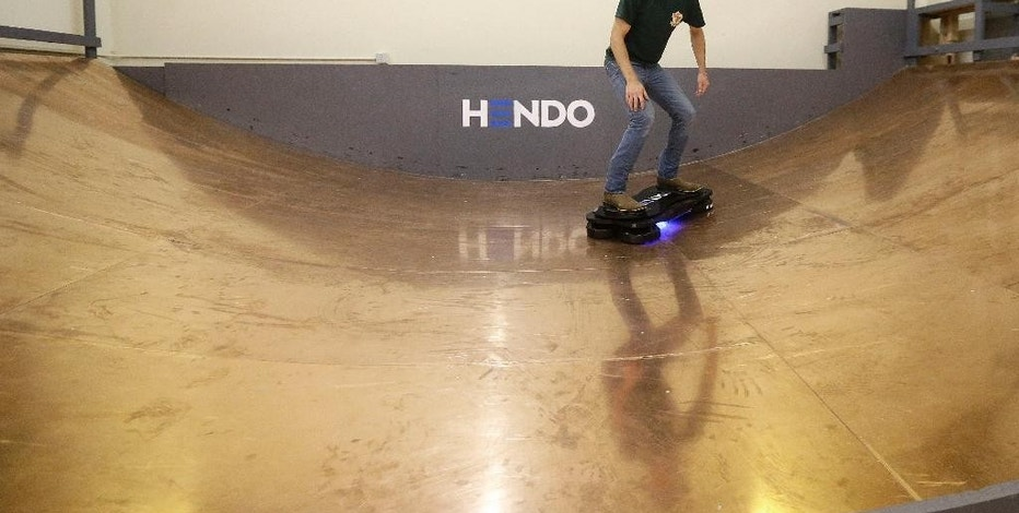 In this Oct. 30, 2014 photo, Arx Pax engineer Garrett Foshay demonstrates riding a Hendo Hoverboard in Los Gatos, Calif. Skateboarding is going airborne this fall with the launch of the first real commercially marketed hoverboard which uses magnetics to float about an inch off the ground. (AP Photo/Jeff Chiu)