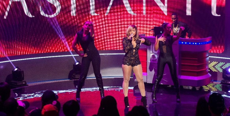 """FILE - In this March 3, 2014 file photo, Ashanti performs on BET's """"106 & PARK"""" in New York. BET says its long-running music-variety series """"106 & Park"""" is airing its last daily episode in Dec. 2014, then going digital. BET said Friday, Nov. 14, 2014, that the """"106 & Park"""" brand is moving online to BET.com.  (Photo by Charles Sykes/Invision/AP, File)"""