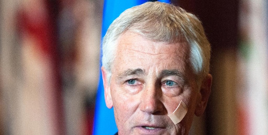 Secretary of Defense Chuck Hagel addresses the media at the Airman's Event during his visit to Minot Air Force Base, N.D., Friday, Nov. 14, 2014. The Pentagon will spend an additional $10 billion to correct deep problems of neglect and mismanagement within the nation's nuclear forces, Hagel declared Friday, pledging firm action to support the men and women who handle the world's most powerful and deadly weapons.  (AP Photo/Kevin Cederstrom)
