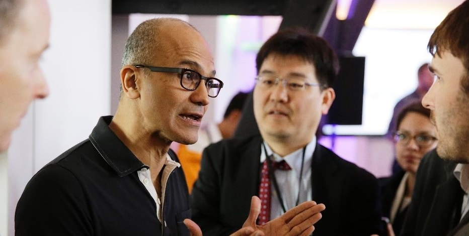 "FILE - In this March 27, 2014 file photo, Microsoft CEO Satya Nadella speaks with reporters after giving a press briefing on the intersection of cloud and mobile computing, in San Francisco. At an October conference celebrating women in computing, Nadella told women they shouldn't ask for a raise _ just trust that ""good karma"" will bring it to them. He later apologized. (AP Photo/Eric Risberg, File)"