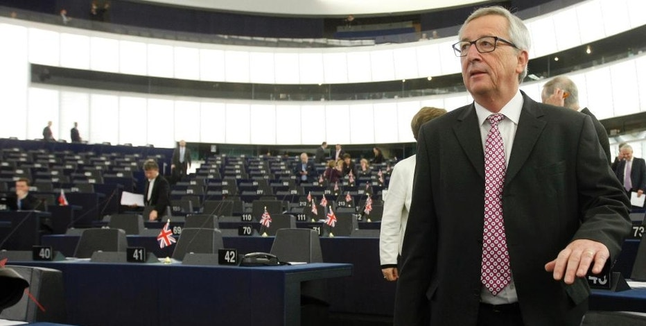 President of the European Commission Jean-Claude Juncker arrives to deliver his statement on growth, jobs and investment package for Europe, Wednesday Nov 26, 2014 at the European Parliament in Strasbourg, eastern France. (AP Photo/Christian Lutz)