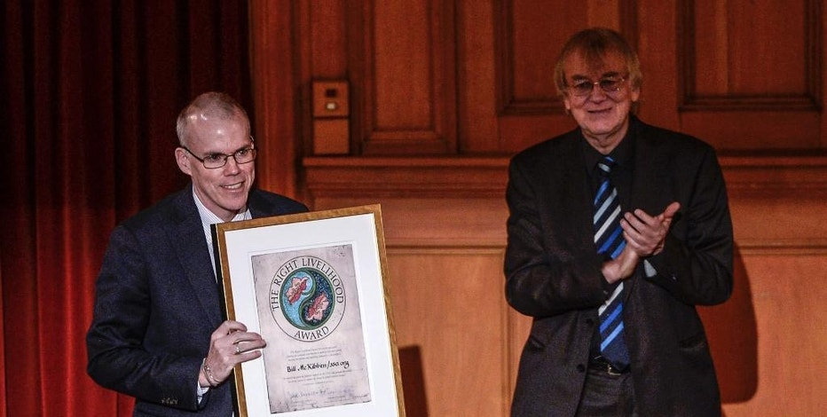 US environmentalist Bill McKibben, left, receives the Right Livelihood Award from Jakob von Uexkull, right, during the Right Livelihood Award ceremony at the Swedish Parliament, in Stockholm, Monday, Dec. 1, 2014. McKibben received the award '...for mobilizing growing popular support in the USA and around the world for strong action to counter the threat of global climate change.' (AP Photo/Pontus Lundahl, TT) SWEDEN OUT