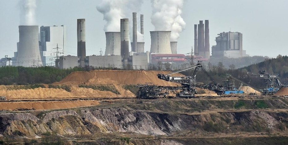 FILE - In this April 3, 2014 file photo, machines dig for brown coal at the open-cast mining Garzweiler in front of a power plant emitting steam near the city of Grevenbroich in western Germany. Six countries produce nearly 60 percent of global carbon dioxide emissions. China and the United States combine for more than two-fifths. The planet's future will be shaped by what these top carbon polluters do about the heat-trapping gases blamed for global warming. (AP Photo/Martin Meissner, File)