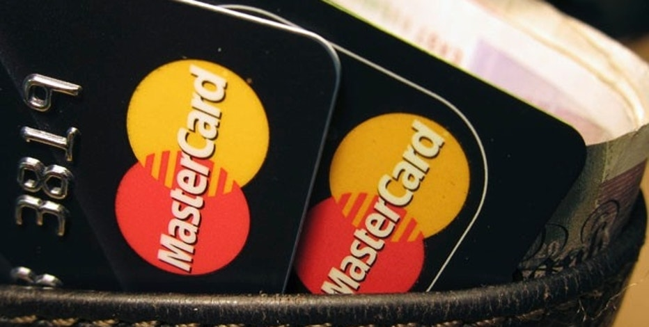 MasterCard credit cards are seen in this illustrative photograph taken in London December 8, 2010. Hackers have crashed the website of credit card firm MasterCard in apparent retaliation for its blocking of donations to the Wikileaks website it was reported on Wednesday.   REUTERS/Jonathan Bainbridge (BRITAIN - Tags: BUSINESS IMAGES OF THE DAY)