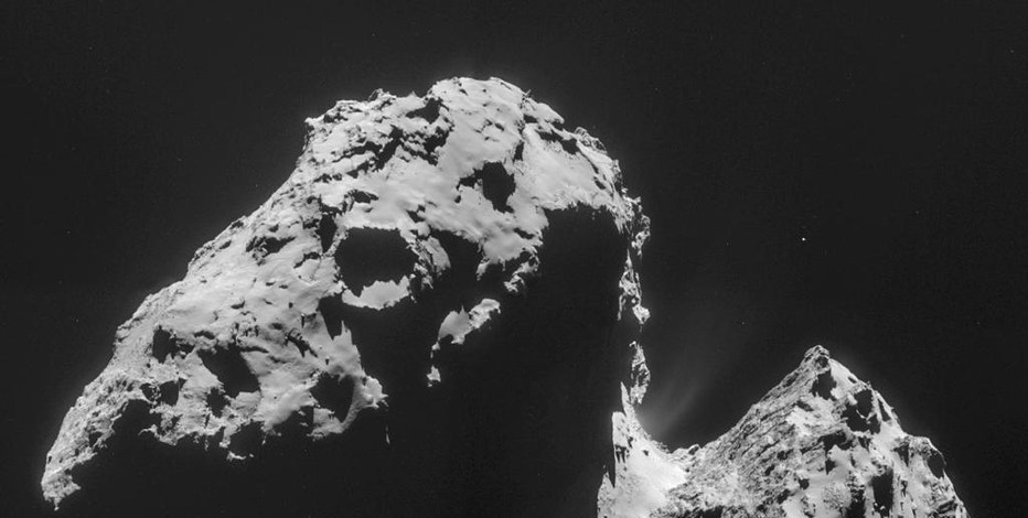 The image comprised of four images taken with the navigation camera on Rosetta and released by the European Space Agency ESA on Thursday, Nov. 20, 2014 shows comet 67P/Churyumov-Gerasimenko on Nov. 17, 2014 from a distance of 42 km (26 miles) from the center of the comet. The mystery of where Earth's water came from has gotten murkier, with astronomers essentially eliminating one of the chief suspects: comets. The European Space Agency's Rosetta space probe closely examined the type of comet that some scientists theorized could have brought water to our planet 4 billion years ago. It found water, but the wrong kind.(AP Photo/ESA)