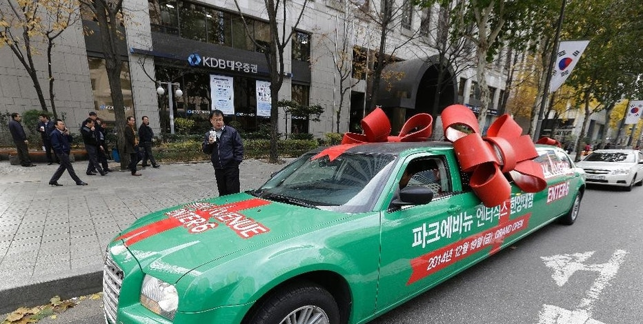 In this Wednesday, Nov. 26, 2014 photo, an imported car is parked on a road side at the Gangnam district in Seoul, South Korea. Gangnam has a special significance in South Korea as the place where a globalized youth culture emerged from a generation that had opportunities to travel and study abroad. The present day Gangnam is still seen as the place that brings foreign culture and ideas to the rest of the country. (AP Photo/Ahn Young-joon)