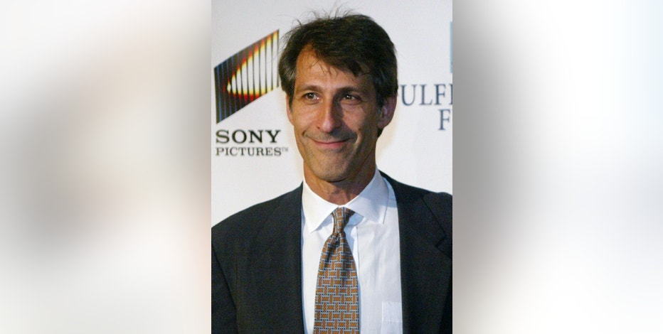 FILE - In this Oct. 13, 2004 file photo, Sony Pictures Entertainment Chairman and Chief Executive Michael Lynton is seen in Beverly Hills, Calif. In the weeks before hackers broke into Sony Pictures Entertainment, the studio suffered significant technology outages blamed on employees keeping too many old emails and hackers targeted executives to trick them into revealing their online credentials. The company's chief executive regularly was reminded in unsecure emails from his executive assistant of his own secret passwords for his and his family's mail, banking, travel and shopping accounts, according to a review of more than 32,000 stolen corporate emails circulating on the Internet. (AP Photo/Danny Moloshok, File)