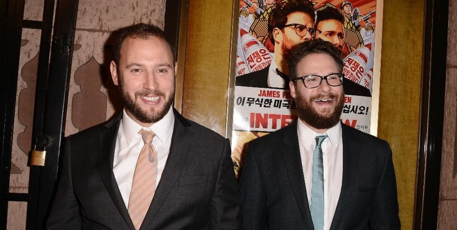 """FILE - In this Dec. 11, 2014 file photo, actor Seth Rogen, right, and director Evan Goldberg attend the premiere of the feature film """"The Interview"""" in Los Angeles. As the dust clears in the Sony hacking attack that has been delivering more dramatic plotlines than any fictional movie, Sony and others involved are trying to move forward and tackle the next steps in minimizing the mess. (Photo by Dan Steinberg/Invision/AP Images, File)"""