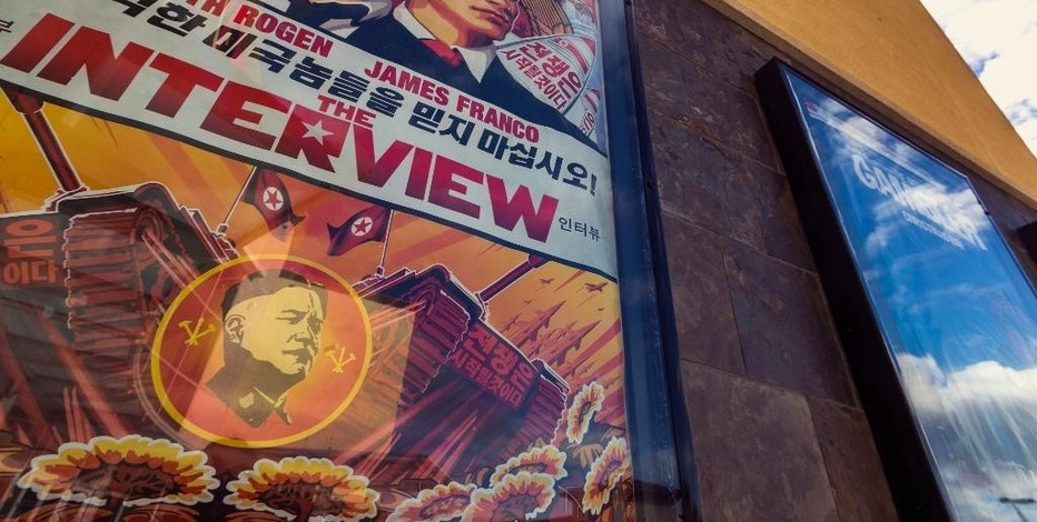 "FILE - This Wed., Dec. 17, 2014 photo shows a movie poster for the movie ""The Interview"" on display outside the AMC Glendora 12 movie theater, in Glendora, Calif. In an unprecedented move, Sony Pictures broadly released ""The Interview"" to digital platforms Wednesday, Dec. 24, 2014, a reversal of its previous plan not to show the film after hackers released thousands of documents online and threatened violence at theaters showing the comedy that depicts the assassination of North Korean leader Kim Jong Un. (AP Photo/Damian Dovarganes, File)"